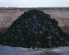 Liu-Bolin-Hiding-in-the-City_95-Coal-Pile-2010