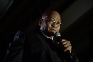(FILES) In this file photo taken on August 08, 2017 South African President Jacob Zuma gestures as he addresses supporters outside the South African Parliament in Cape Town after surviving a Motion of No confidence. South Africa postponed the State of the Nation address on February 6, 2018 parliament speaker Baleka Mbete announced. / AFP PHOTO / PIETER BAUERMEISTER
