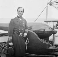 John A. Dahlgren standing next to a 50-pounder Dahlgren rifle aboard USS Pawnee, 1865.