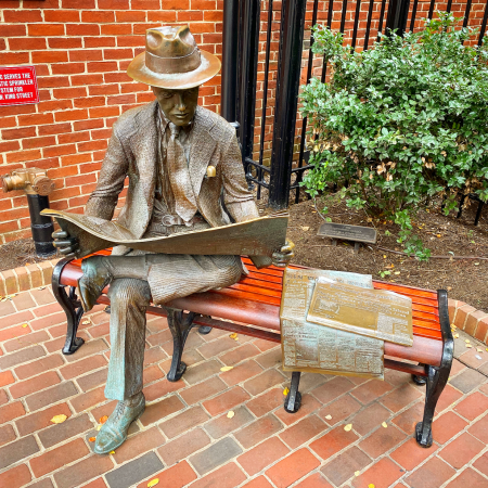 newspaper reader statue