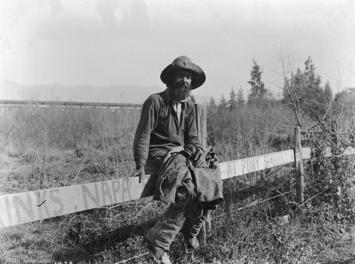 Hobo_sitting_on_a_fence,_ca.1920_(CHS-1428)