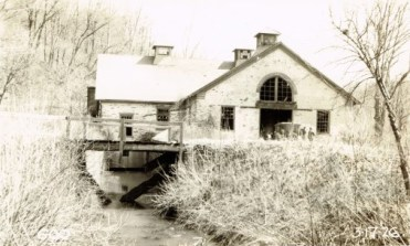 Colemanville Water & Power Company hydroelectric powerplant with trailrace visible.