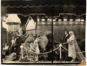 Window display at Watt and Shand showing formal wear for weddings.