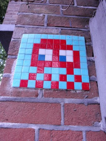 One of 26 mini-mosaics installed by French urban artist Invader in 2000