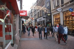 Festive lights add holiday cheer to popular shopping streets like Kalverstraat.