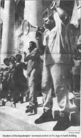 Larry Farrar and other members of the Housekeepers Association on the steps of South Building, Photo by Erin Randall in The Daily Tar Heel, 18 September 1992, Page 1.