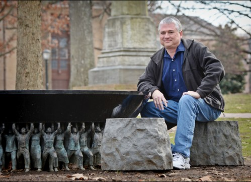"Tim McMillan, creator of the Black & Blue Tour, at the Unsung Founders Memorial on McCorkle Place. ""'Black and Blue' tour traces Carolina's racial history,"" University Gazette, 11 February 2014."