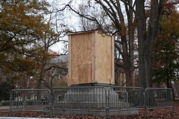 Plinth of the Confederate Monument Surrounded by Plywood Before Protest on 3 December 2018, Photo by Emily Caroline Sartin in The Daily Tar Heel, 3 December 2018.