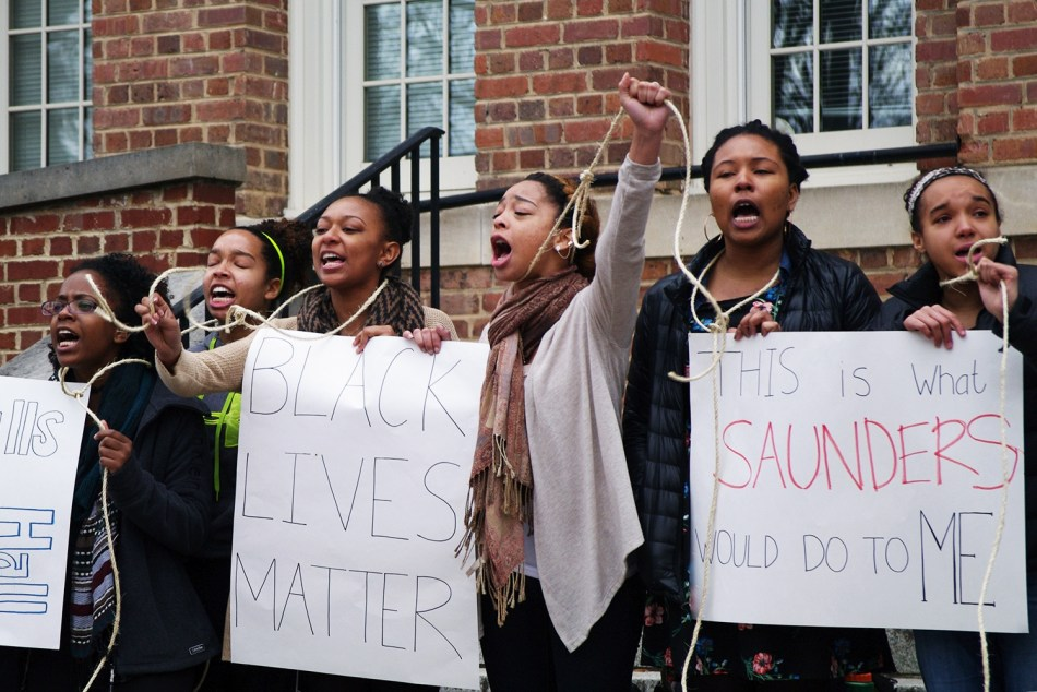 """""""This Is What Saunders Would Do To Me?."""" Photo by Claire Collins in Lamm, Stephanie, """"Students protested history of aggression outside Saunders Hall,"""" The Daily Tar Heel, 3 February 2015."""
