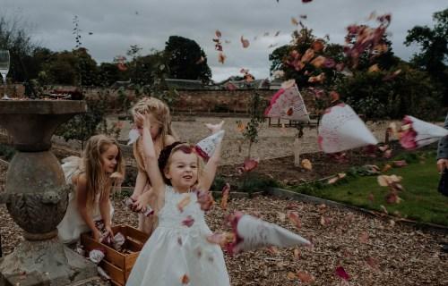 Christine McNally Photograhy 1 - Confetti flower girl playful photography