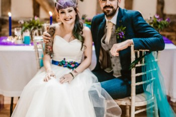 Peacock barns - alternative unconventional wedding photoshoot - rustic decadent - happy couple at table