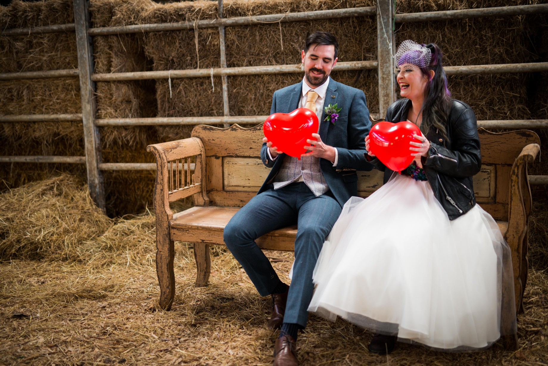 Peacock barns - alternative unconventional wedding photoshoot - rustic decadent - bride and groom with hearts