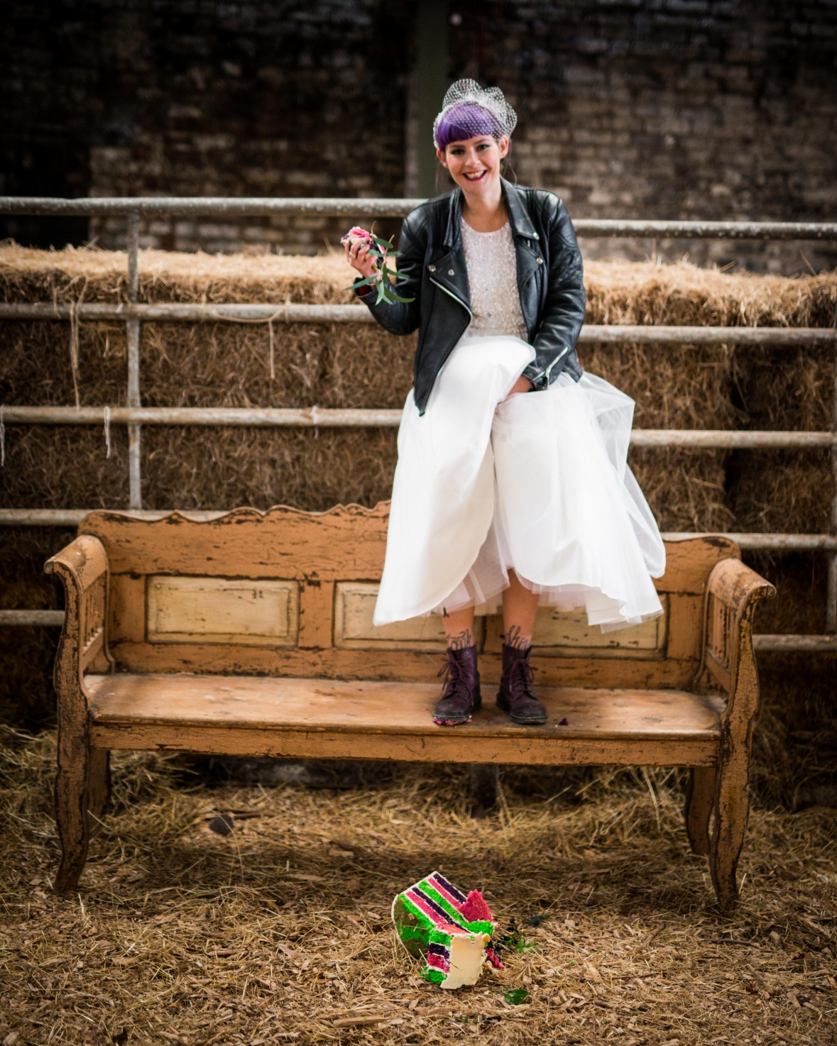 Peacock barns - alternative unconventional wedding photoshoot - rustic decadent - bride on bench - purple boots