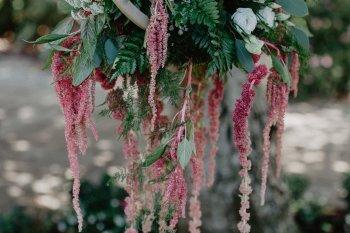 EmilyandGeoff- Nicki Shea Photography- Circus Wedding hanging flowers