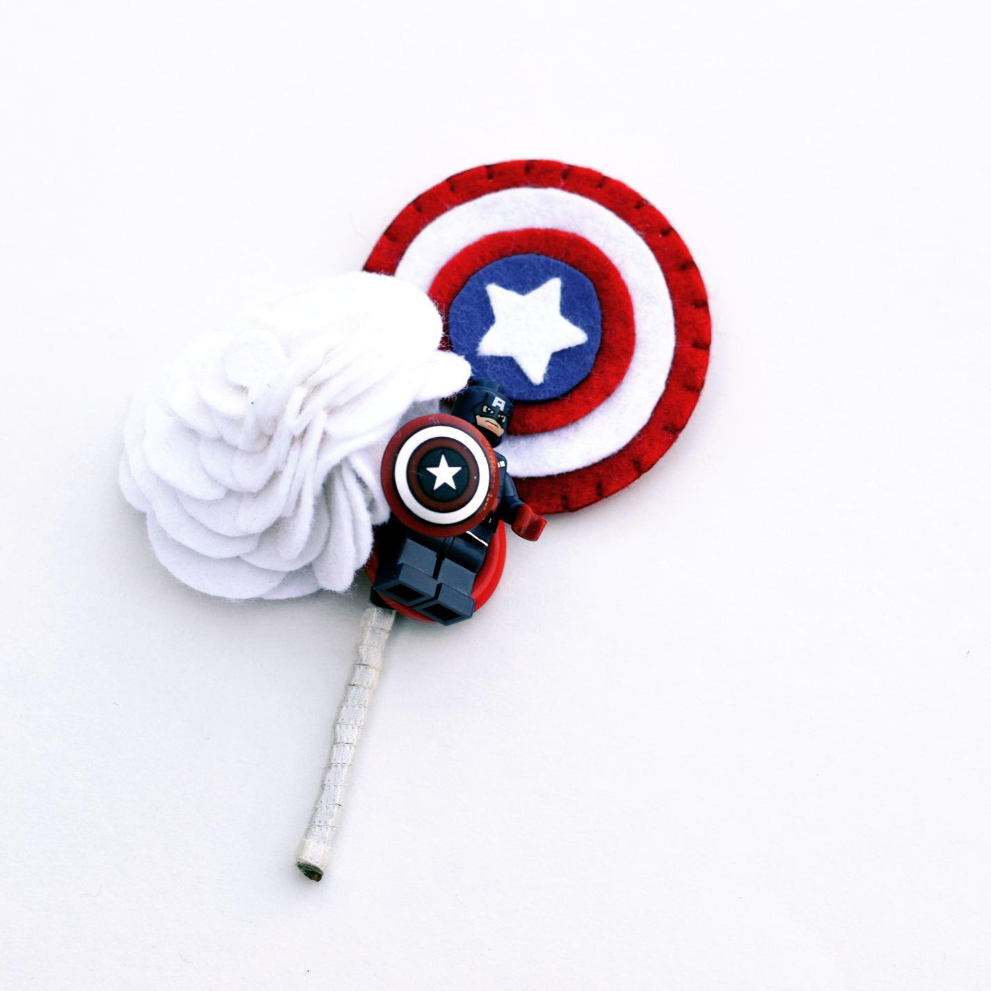 Photo by Charlotte Laurie designs - alternative wedding buttonhole - captain america button hole