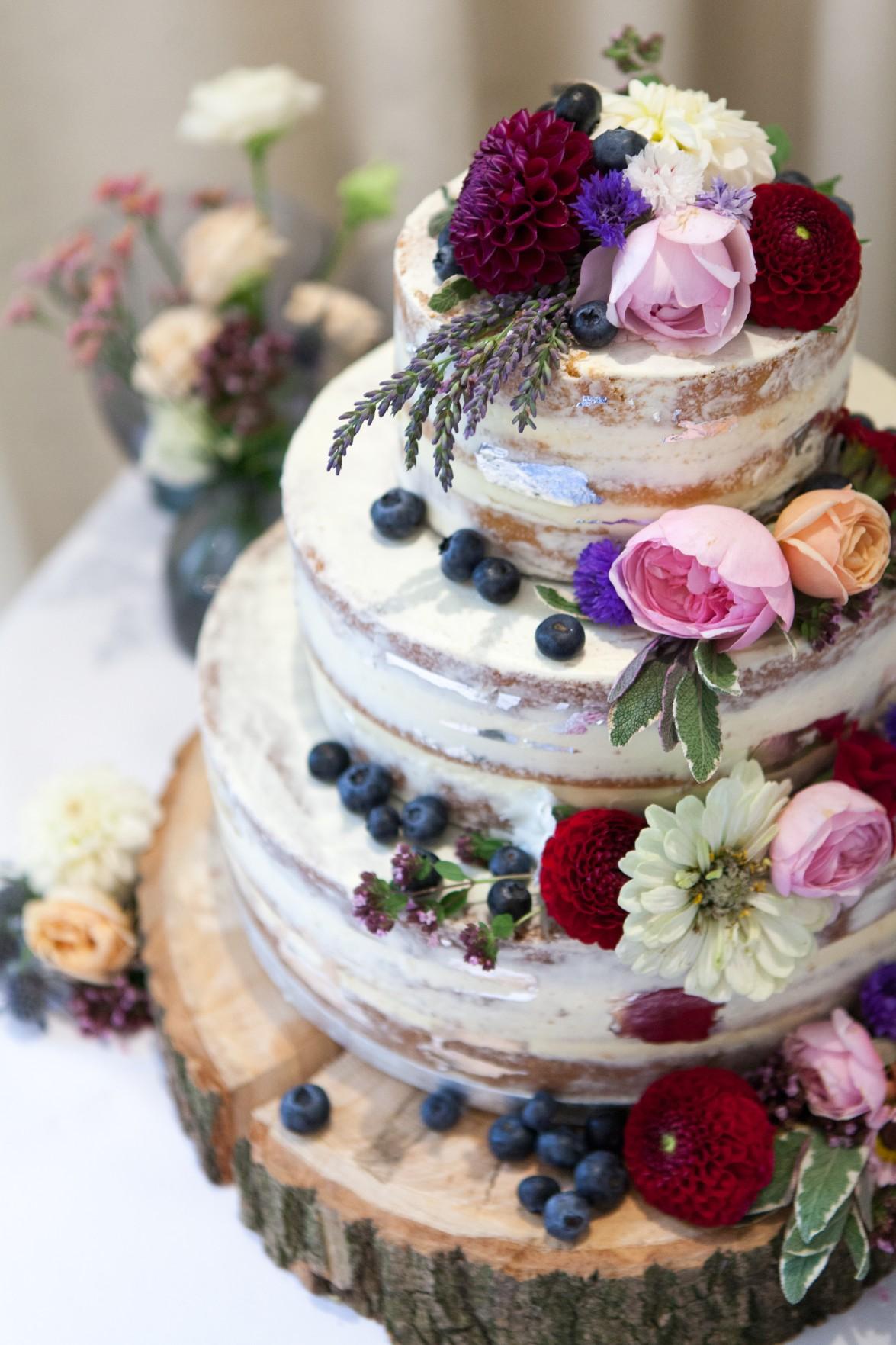 naked wedding cake with flower decoration - unique wedding cakes