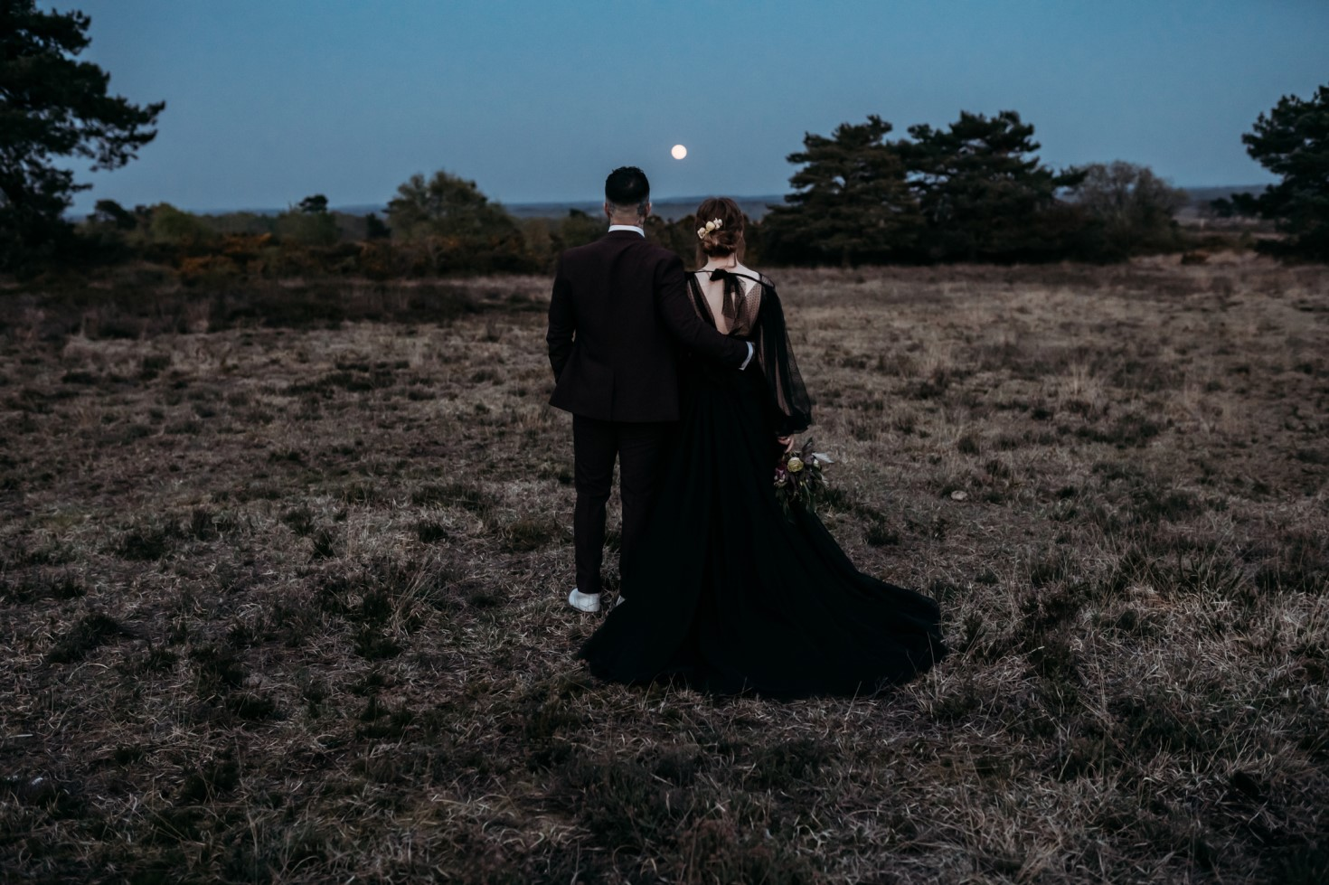 Finn And The Fox Photography-Moody Elopement Wedding- Gothic wedding - Black wedding dress - Sunset wedding picture - alternative wedding picture