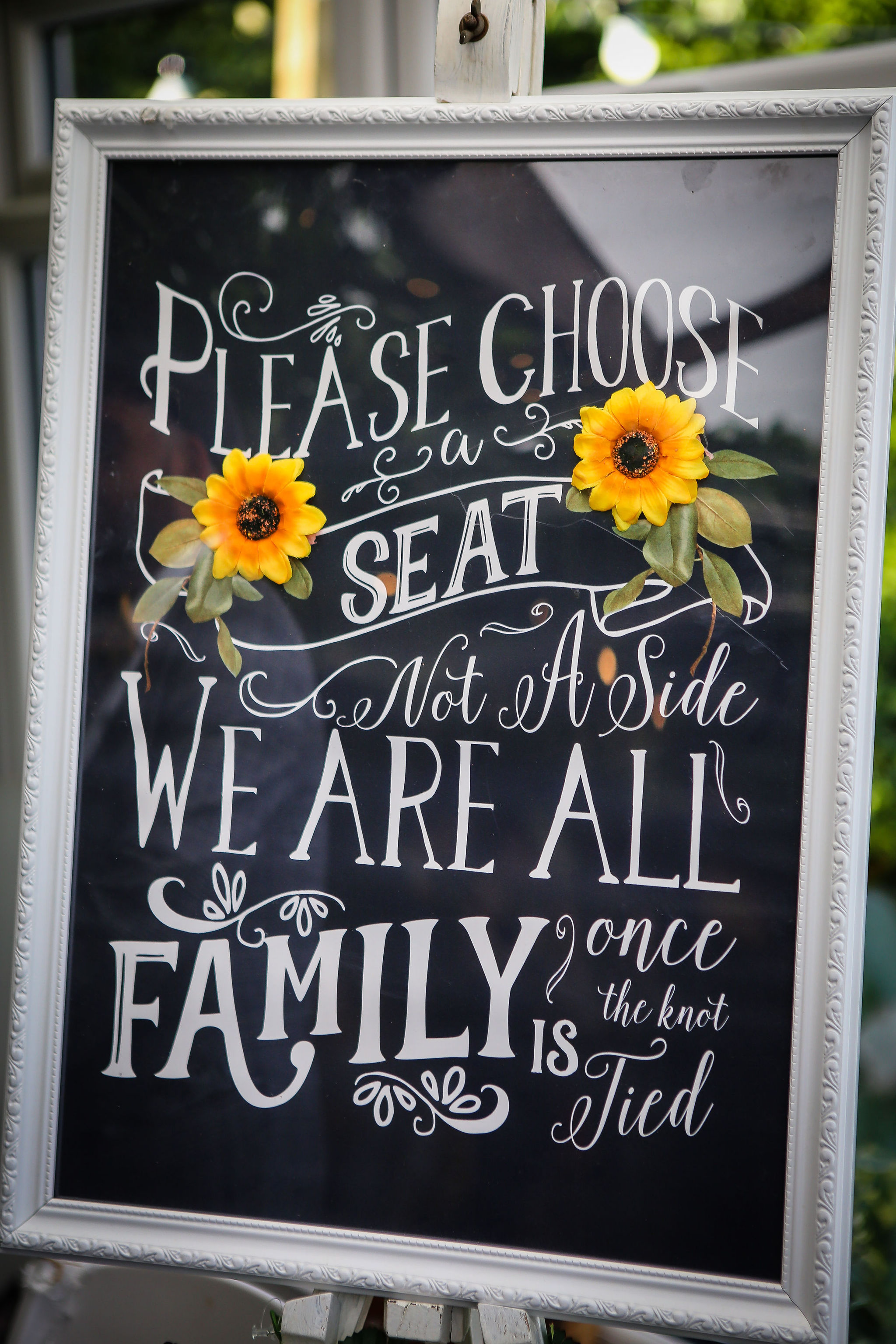Harriet&Rhys Wedding - Magical sunflower wedding - choose a seat not a side we are all family