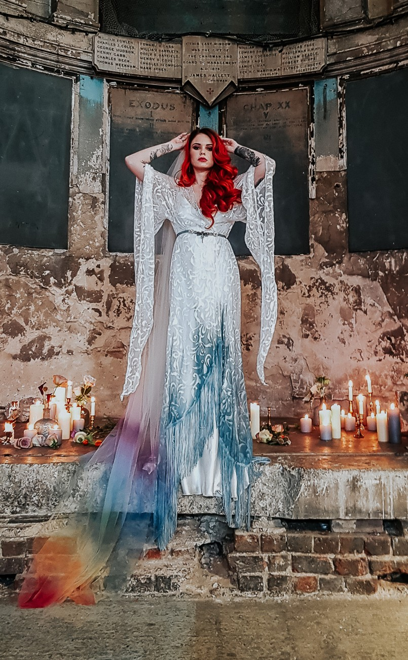 alternative bride wedding dress at the asylum chapel, london by bexbride - eclectic brides - multi coloured veil - dip dye wedding dress with sleeves - bride with red coloured hair and belt in the chapel - quirky wedding accessories