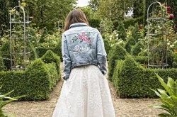 Handpainted denim jacket - bride jacket - pink roses - by ophelia rose hand painted bridal jackets - taken in gardens - outdoor wedding day - alternative bridalwear with red shoes