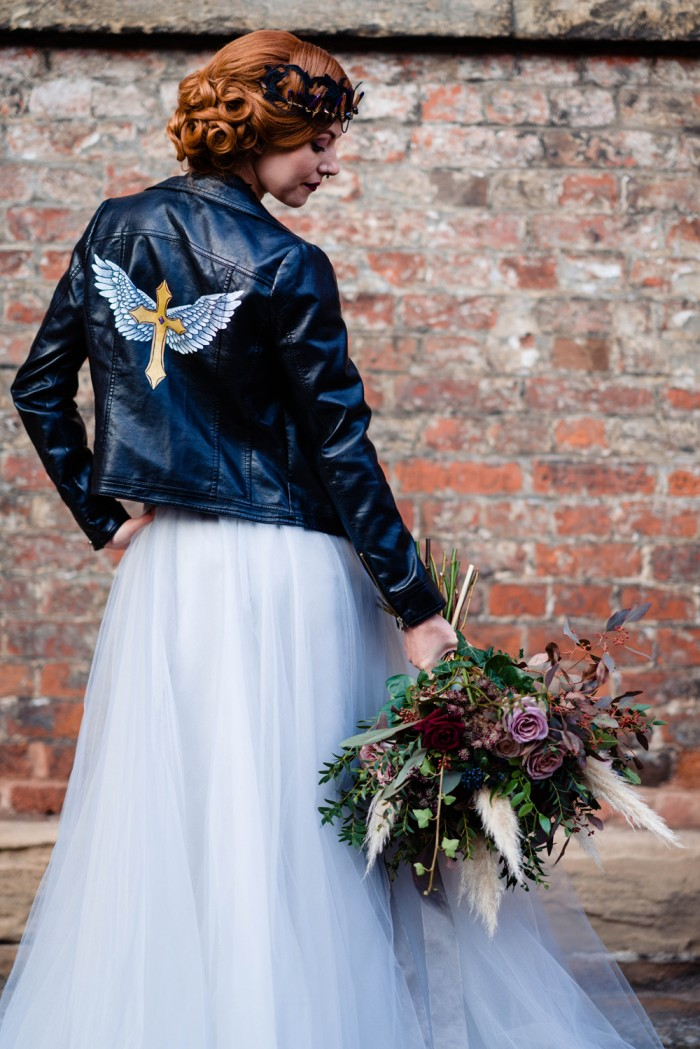 hand painted gothic leather jacket with decorative cross and angel wings - gothic wedding ideas taken at the national justice museum, nottingham by Vicky Clayson Photography
