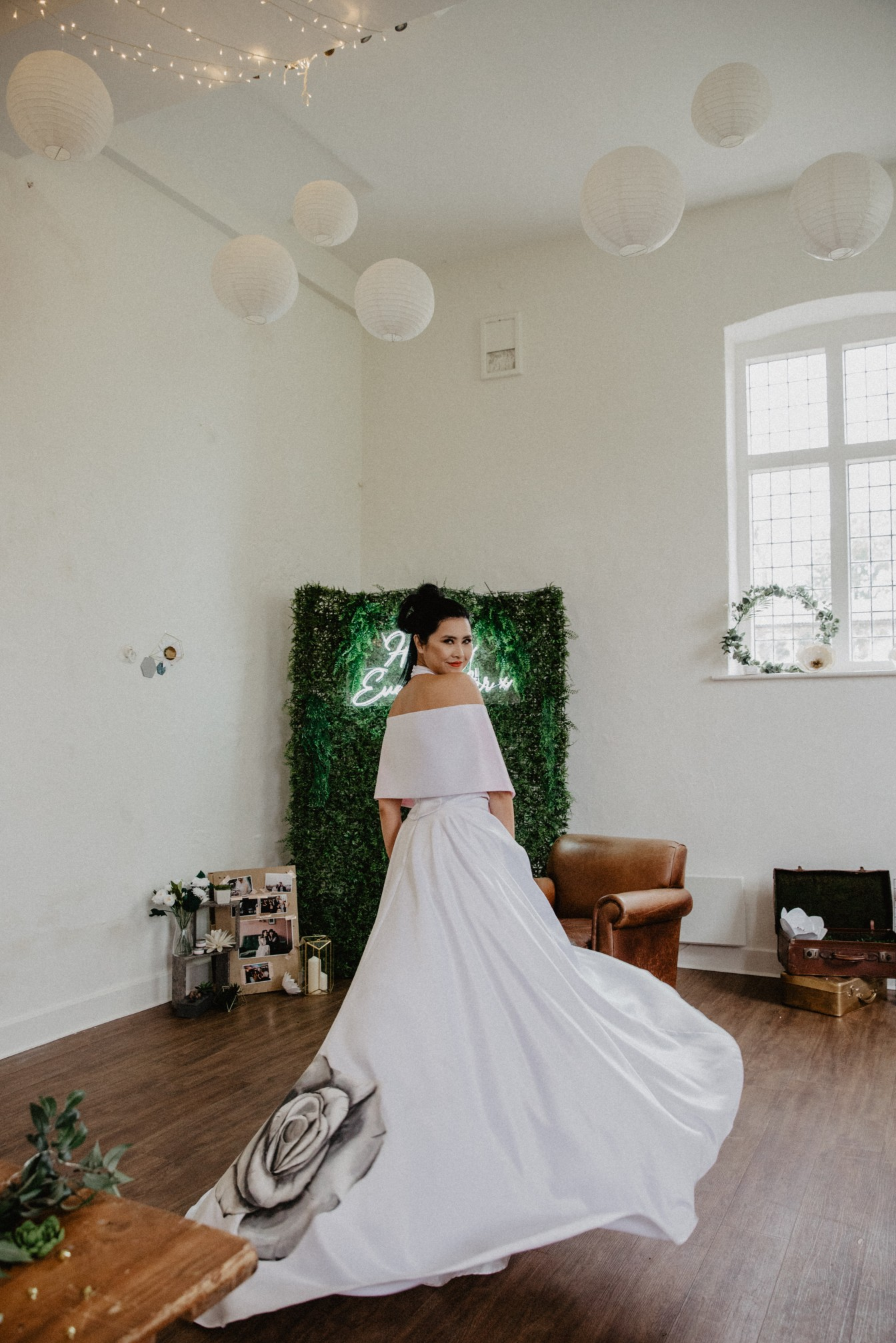 bride twirling with hand painted wedding dress with black roses from aylin white designs - bespoke hand painted bridal gowns -