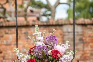 Big Day Blooms and Cakes - Wedding Florist - Wedding Cakes - Nottingham East Midlands - Flower arrangement on a swing
