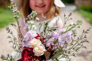 Big Day Blooms and Cakes - Wedding Florist - Wedding Cakes - Nottingham East Midlands - natural wedding bouquet held by child
