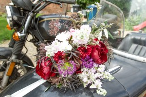 Big Day Blooms and Cakes - Wedding Florist - Wedding Cakes - Nottingham East Midlands - wedding bouquet with white and red flowers on a motor bike