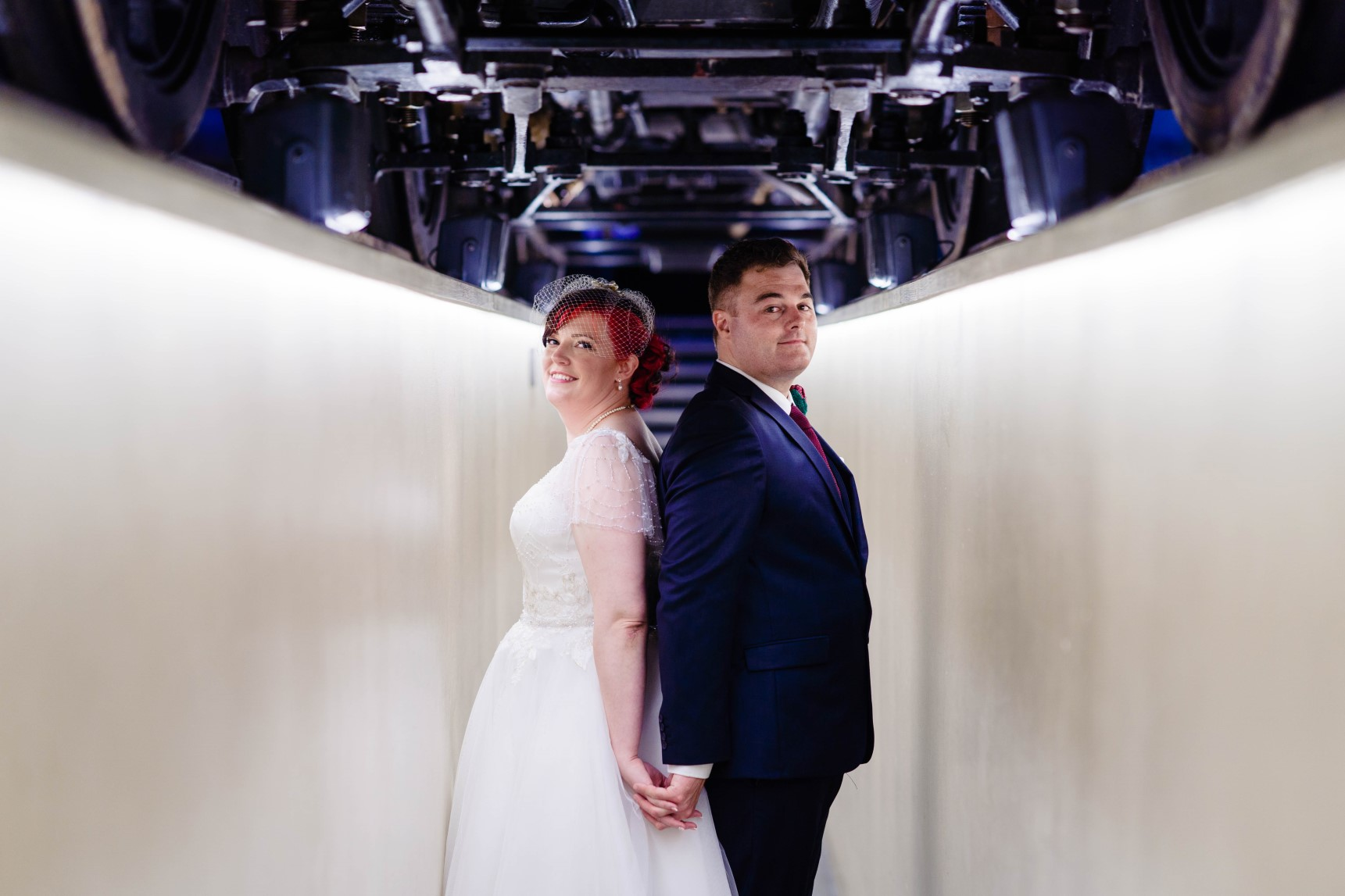 Industrial Railway Wedding- Vicki Clayson Photography- Unconventional Wedding- Unique Wedding Venue- wedding photo under train