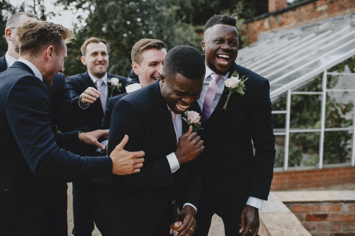 Getting Married Abroad- Grooms Perspective- Wedding Planning for Men- Unconventional Wedding- Nathan Walker Photography- Groomsmen laughing