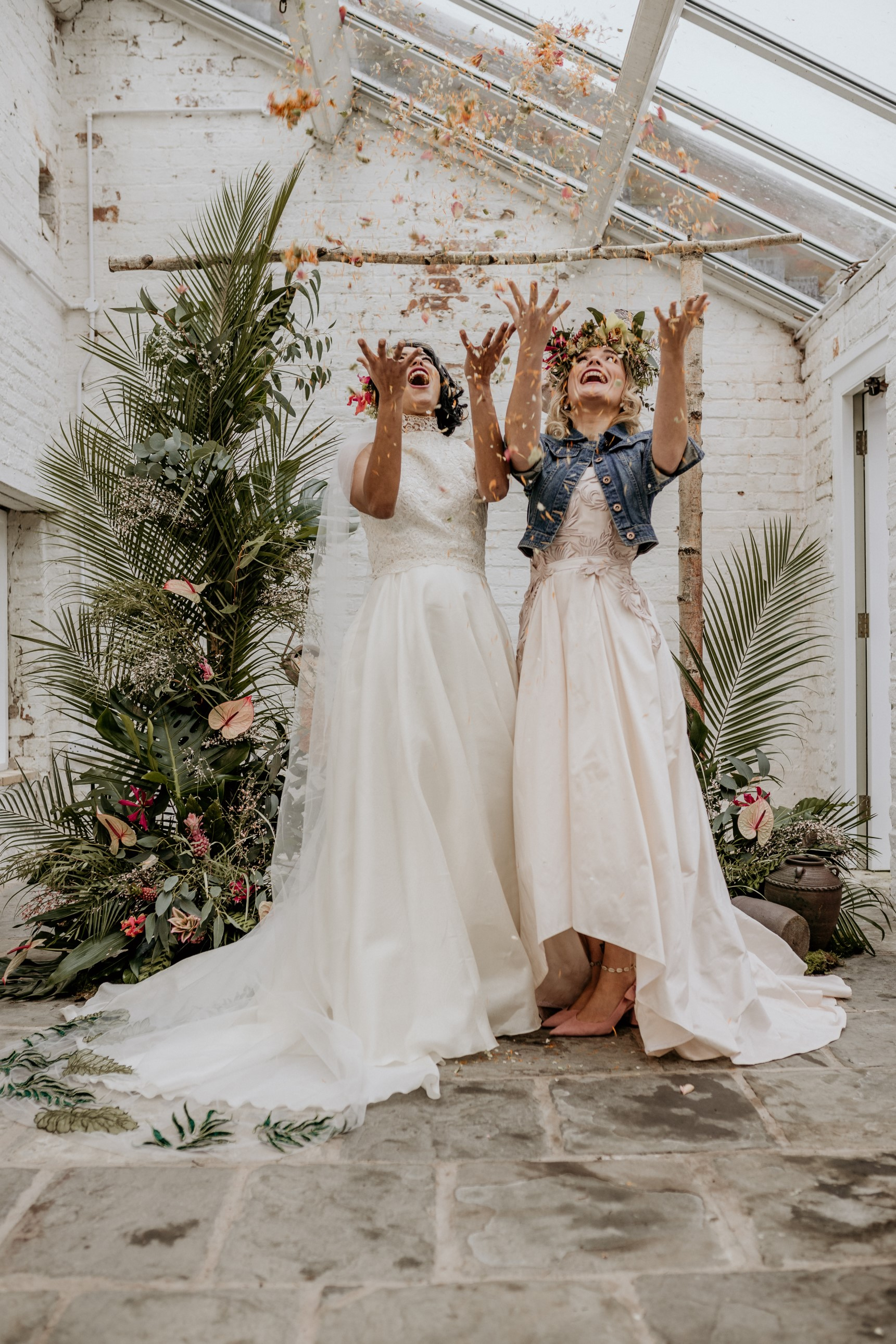tropical opulence wedding- tropulence- twigs branch photography- unconventional wedding- brides throwing confetti