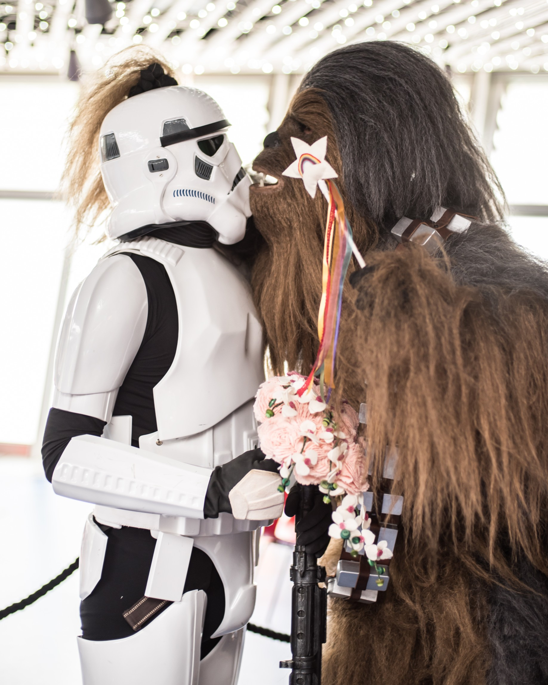 Star Wars wedding photo featuring Imperial army storm trooper holding bouquet and chewbacca holding fairy wand - by charlotte laurie designs with Imperial Icons - themed wedding ideas