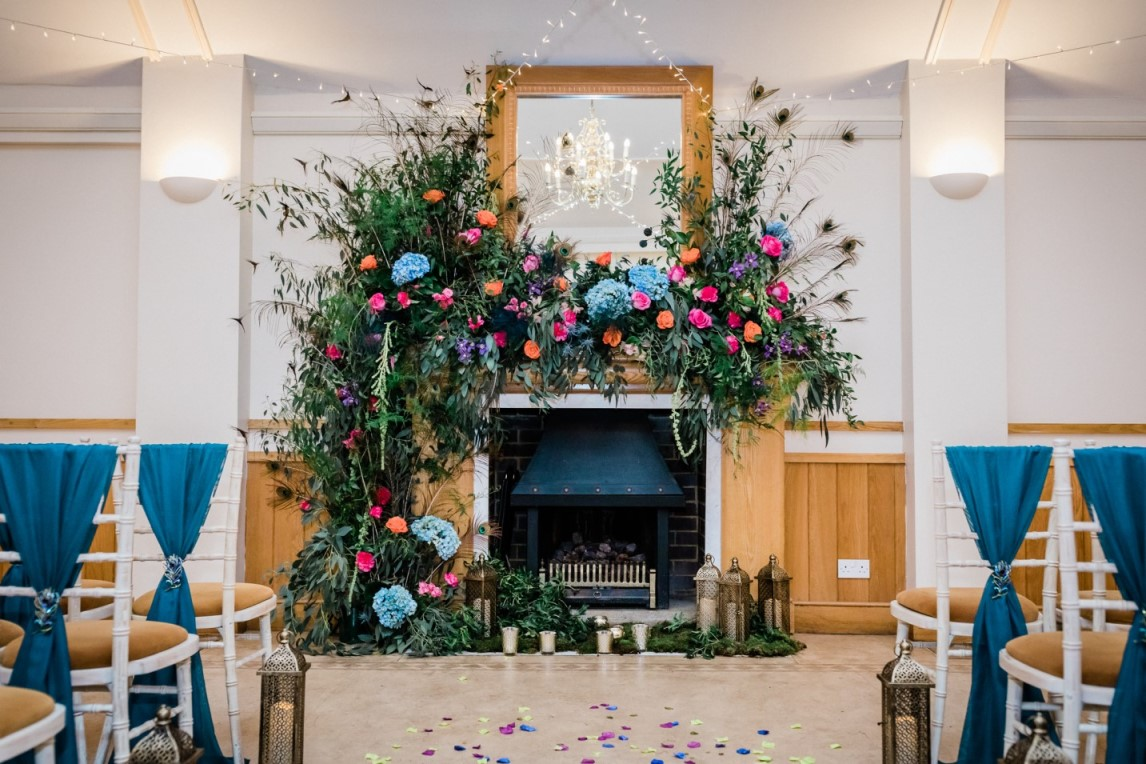 peacock wedding- unconventional wedding- colourful wedding flowers- wedding floral display