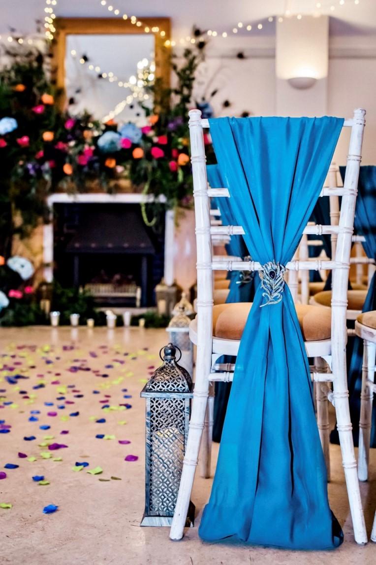 peacock wedding- unconventional wedding- unique wedding chair covers- teal chair cover- peacock wedding theme- peacock wedding styling