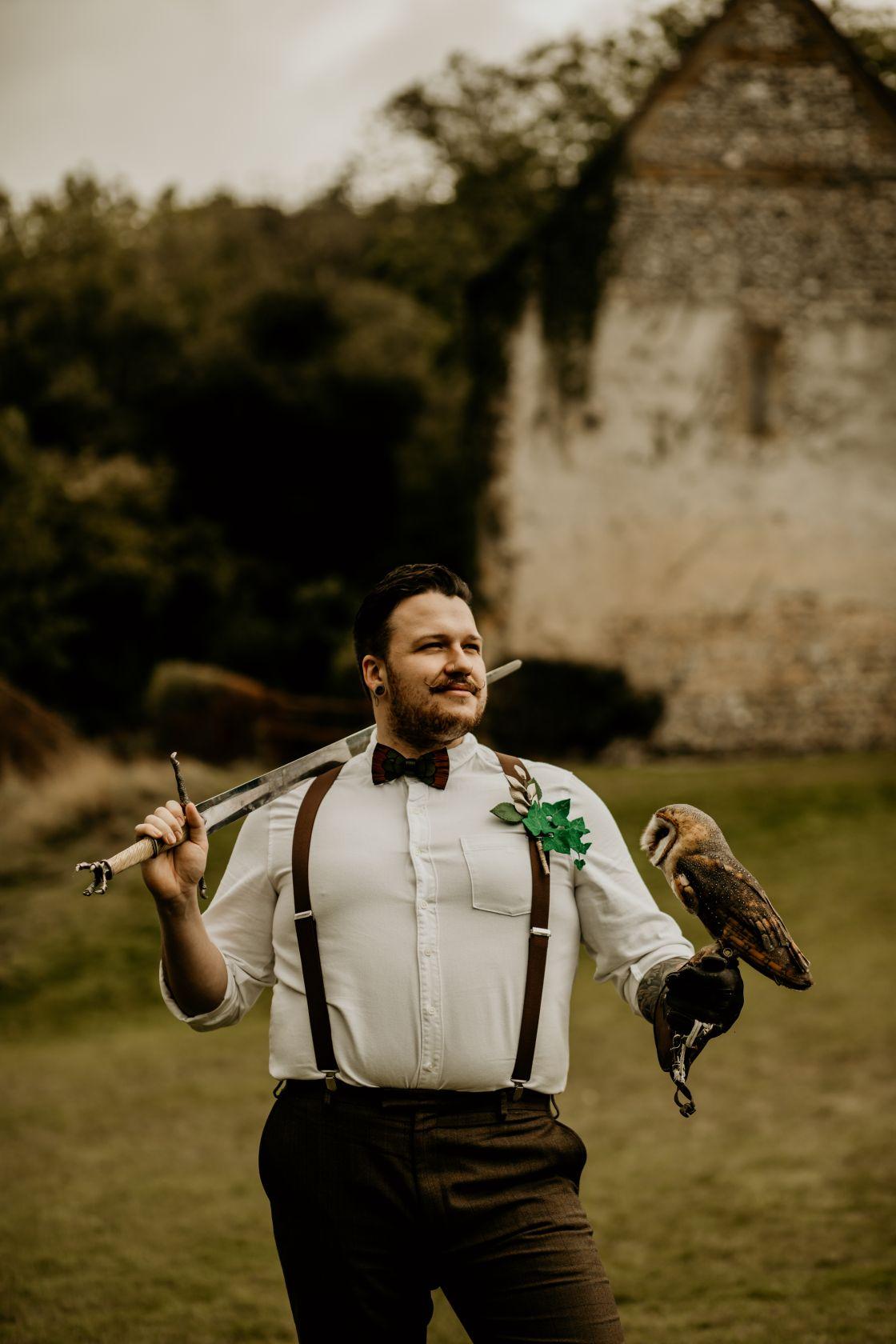 alternative fairytale wedding- snow white wedding- charlotte laurie designs-chloe mary photo- unconventional wedding- alternative wedding inspiration- sword at wedding- wedding owl- groom with owl
