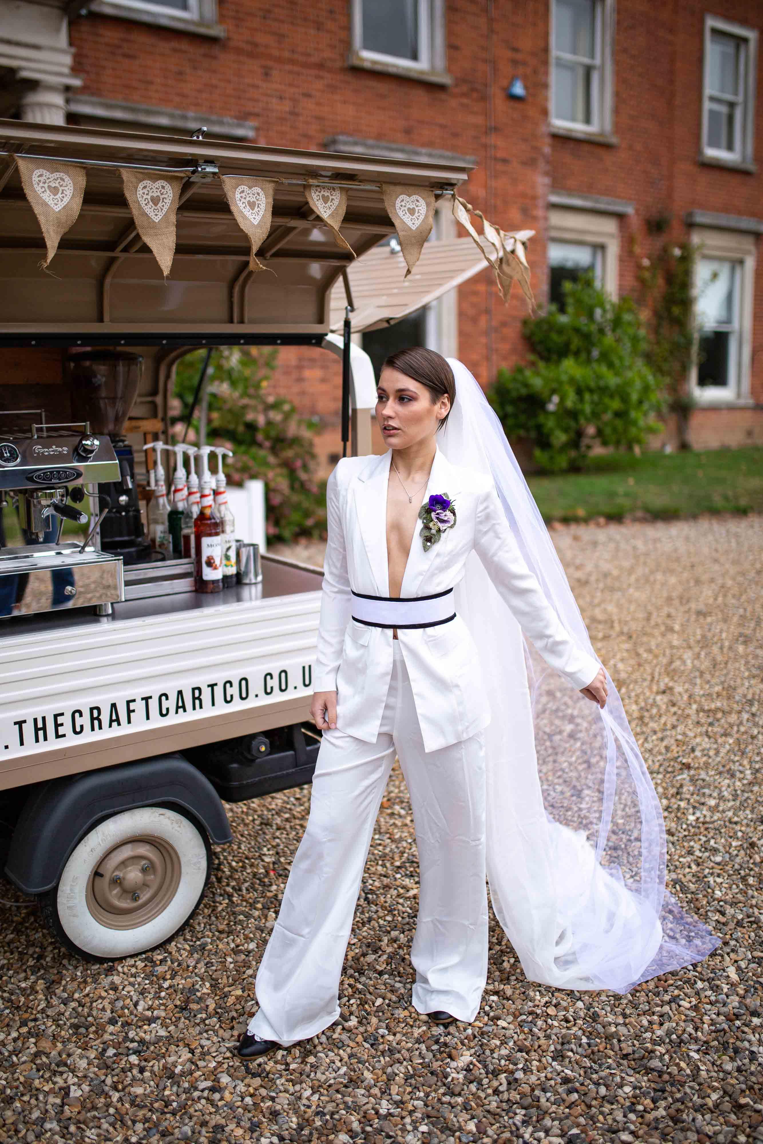 iconic wedding looks- music themed wedding- unconventional wedding- alternative wedding- wedding suit- wedding jumpsuit- alternative bridalwear- annie lennox style