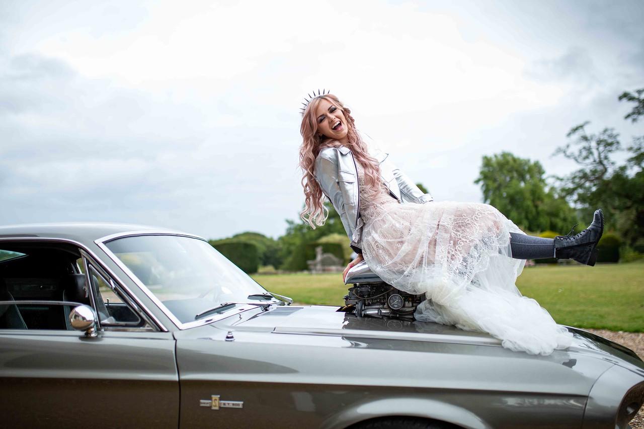 iconic wedding looks- music themed wedding- unconventional wedding- alternative wedding- courtney love style- wedding car-punk wedding look- grunge wedding
