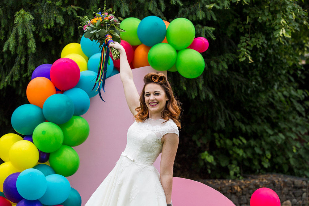 flamingo wedding - colourful wedding - rainbow wedding - garden wedding - summer wedding - unconventional wedding - alternative wedding- bride with bouquet in the air
