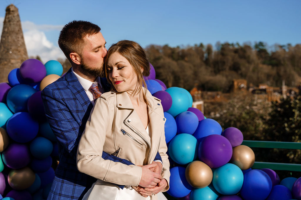 peacock themed wedding - peacock wedding - unique wedding colour scheme - quirky wedding - luxurious wedding - wedding balloons - purple wedding - bride and groom portrait