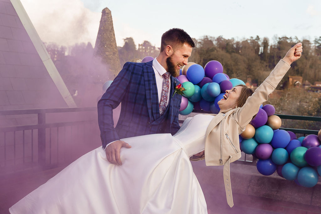 peacock themed wedding - peacock wedding - unique wedding colour scheme - quirky wedding - purple wedding - wedding smokebomb photo