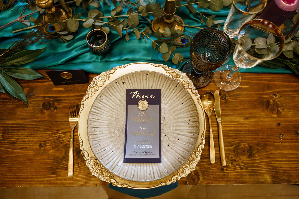 peacock themed wedding - peacock wedding - unique wedding colour scheme - quirky wedding - luxurious wedding - luxurious wedding menu- gold wedding cutlery- unique wedding stationery