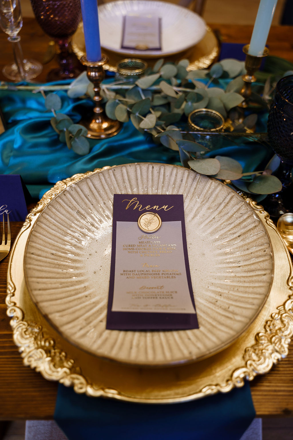 peacock themed wedding - peacock wedding - unique wedding colour scheme - quirky wedding - luxurious wedding - unique wedding menu- gold wedding cutlery