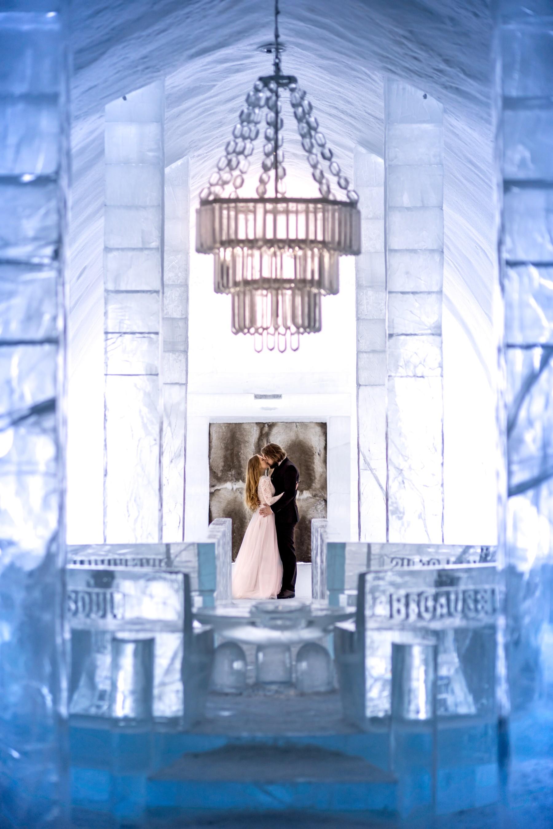 winter wedding at icehotel sweden - cinematic wedding photography - ice wedding - elopement in sweden - creative wedding photographer - unconventional wedding - alternative wedding - unique wedding - artistic wedding - bride and groom kiss