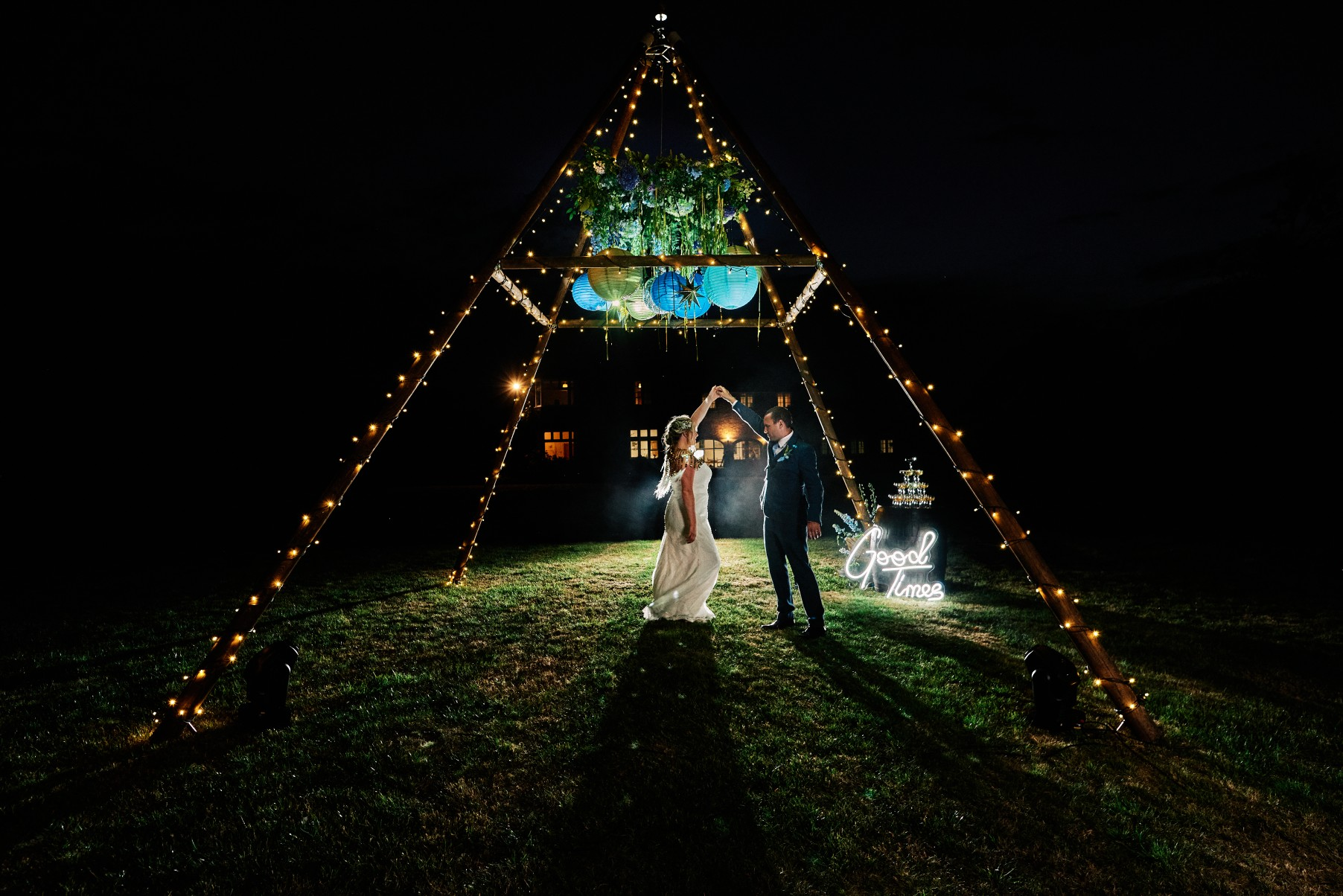nhs wedding - paramedic wedding - blue and gold wedding - outdoor wedding - micro wedding - surprise wedding - bride and groom dancing in naked tipi