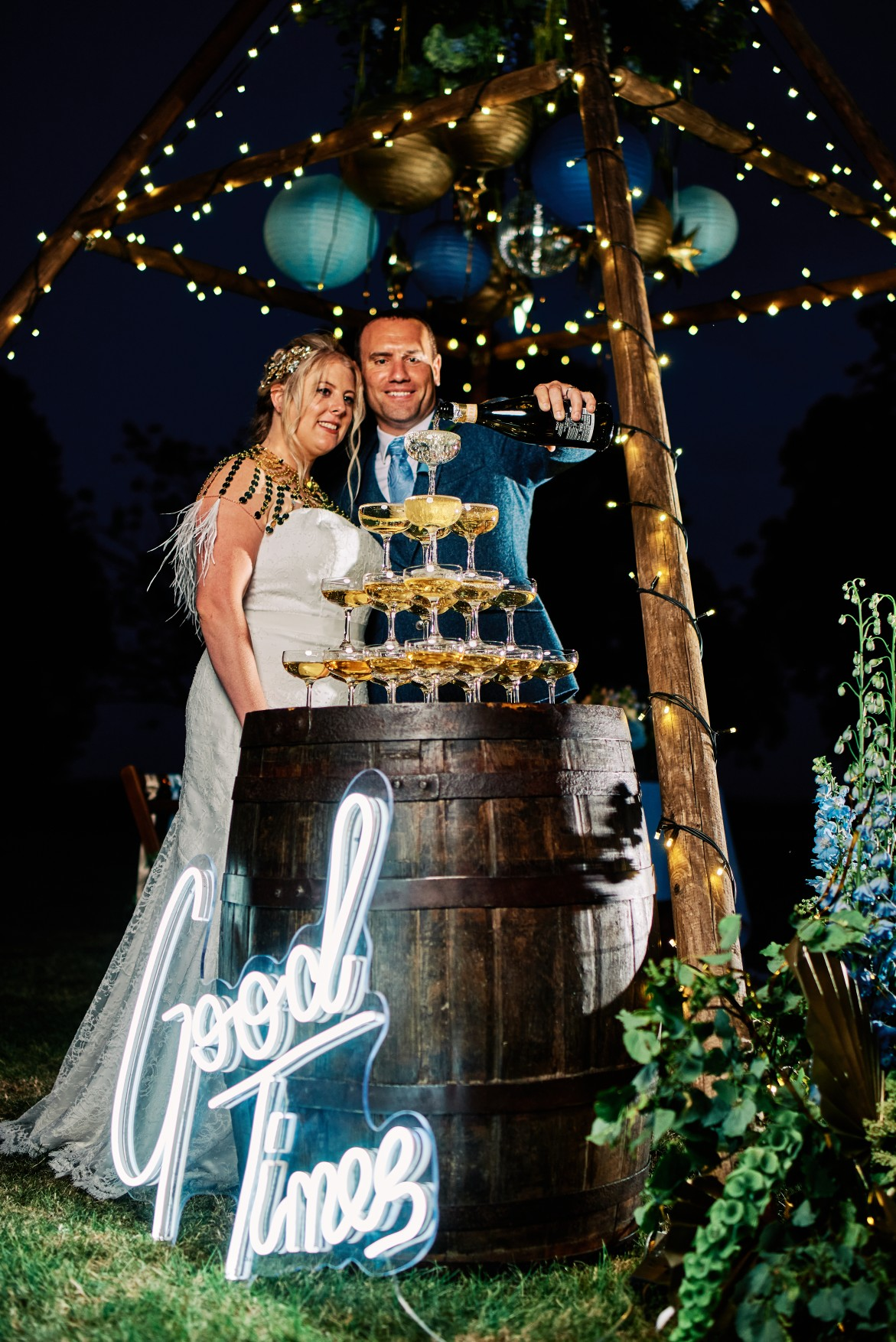 nhs wedding - paramedic wedding - blue and gold wedding - outdoor wedding - micro wedding - surprise wedding - bride and groom pouring champagne