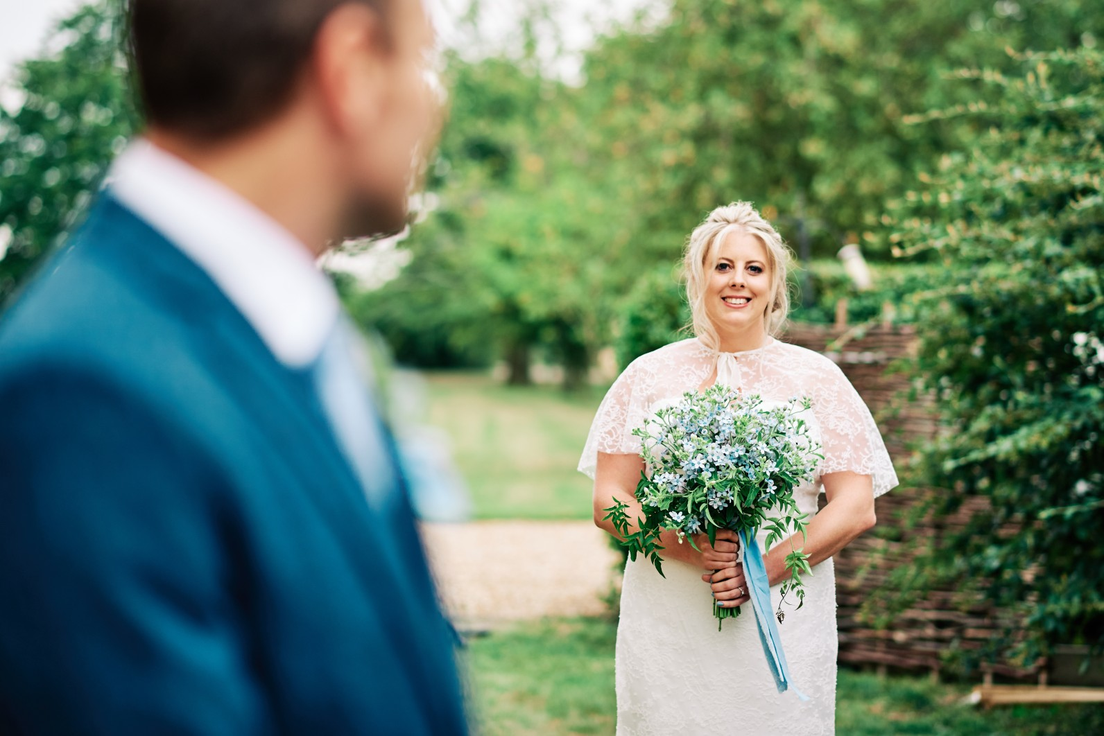 nhs wedding - paramedic wedding - blue and gold wedding - outdoor wedding - micro wedding - surprise wedding - elegant wedding dress and bridal cape