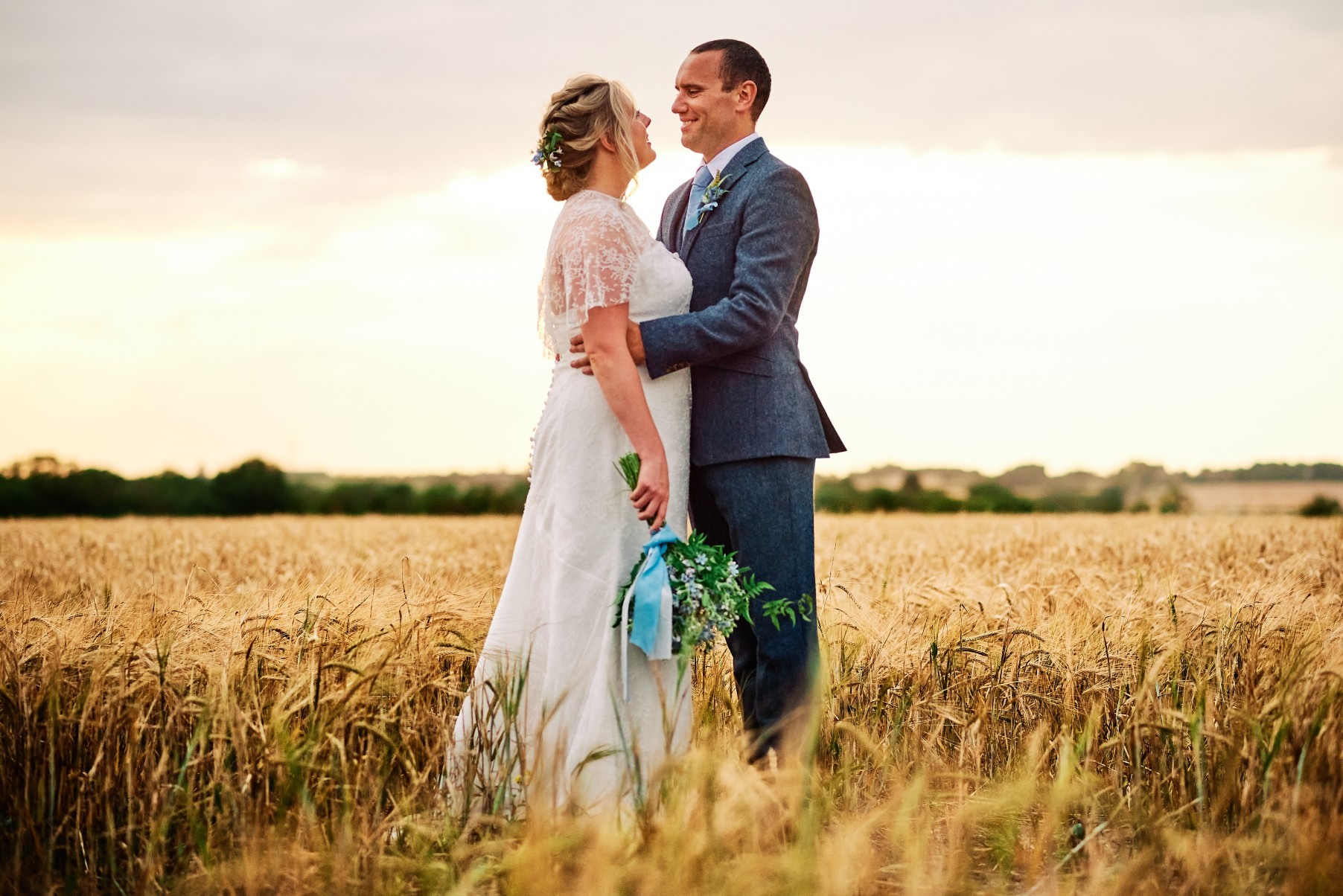 nhs wedding - paramedic wedding - blue and gold wedding - outdoor wedding - micro wedding - surprise wedding - bride and groom in field