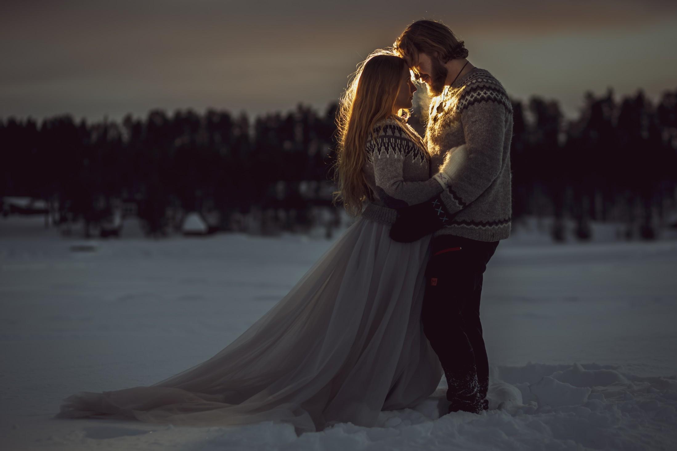 winter wedding at icehotel sweden - cinematic wedding photography - ice wedding - elopement in sweden - creative wedding photographer - unconventional wedding - alternative wedding - unique wedding - bride and groom in snow