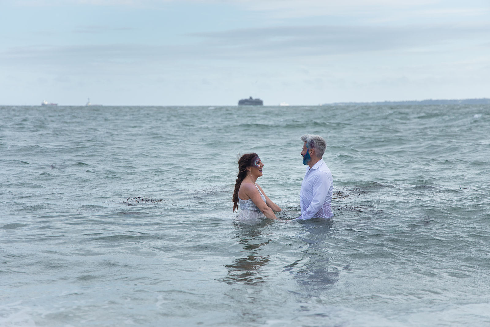 mermaid wedding - beach wedding - quirky wedding - unique wedding - alternative seaside wedding - alternative wedding - bride and groom swimming in sea